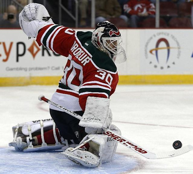 New Jersey Devils goalie Martin Brodeur makes a save on a shot by the Boston Bruins during the first period of an NHL hockey game, Tuesday, March 18, 2014, in Newark, N.J. (AP Photo/Julio Cortez)