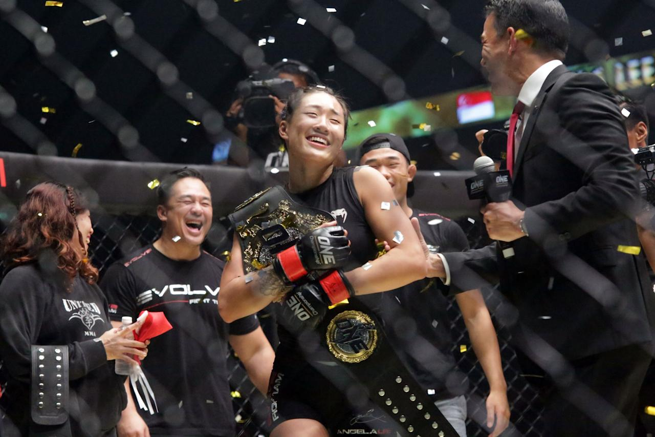<p>Angela Lee holds her atomweight belt after defending her ONE Championship title on 26 May 2017. (PHOTO: Dhany Osman / Yahoo Newsroom) </p>