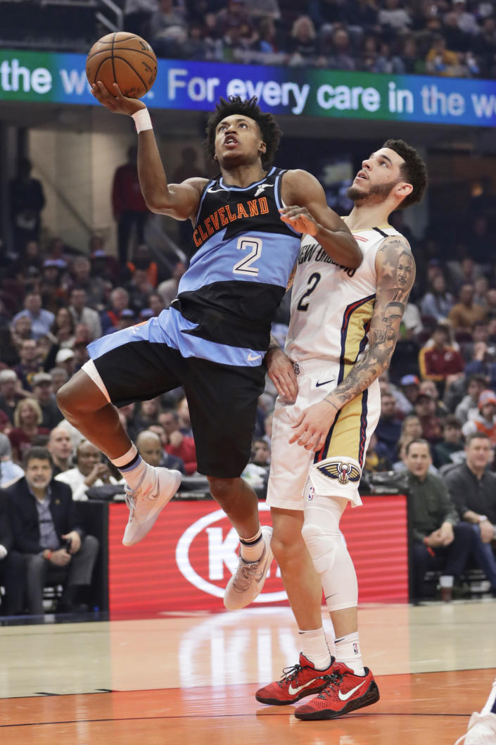 Cleveland Cavaliers' Collin Sexton, left, drives next to New Orleans Pelicans' Lonzo Ball during the first half of an NBA basketball game Tuesday, Jan. 28, 2020, in Cleveland. (AP Photo/Tony Dejak)
