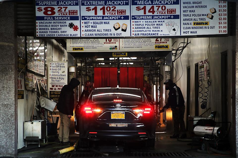 NEW YORK, NY - JANUARY 20: A car pulls into the Vegas Auto Spa where workers are on strike on January 20, 2015 in New York City.  Eight workers from the popular car wash have filed a federal lawsuit against their employer and have been on strike for two months over issues of pay, hours, safe working conditions and the right to join a union. The suit alleges that they were paid less than minimum wage and it demands $600,000 in overtime and other back wages. The car wash industry has a long history with issues of worker exploitation in America.  (Photo by Spencer Platt/Getty Images)