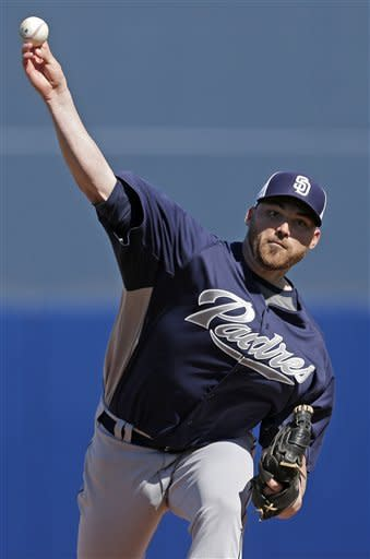 San Diego Padres starting pitcher Sean O'Sullivan throws during an exhibition spring training baseball game against the Seattle Mariners Friday, Feb. 22, 2013, in Peoria, Ariz. (AP Photo/Charlie Riedel)