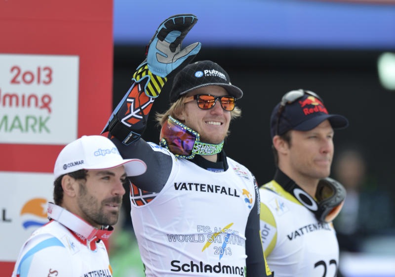 United States' gold medalist Ted Ligety is flanked by France's Gauthier de Tessieres, left, silver and Norway'sAksel Lund Svindal bronze after the men's super-G at the Alpine skiing world championships in Schladming, Austria, Wednesday, Feb.6,2013. Right is Norway'sAksel Lund Svindal, bronze. (AP Photo/Kerstin Joensson)