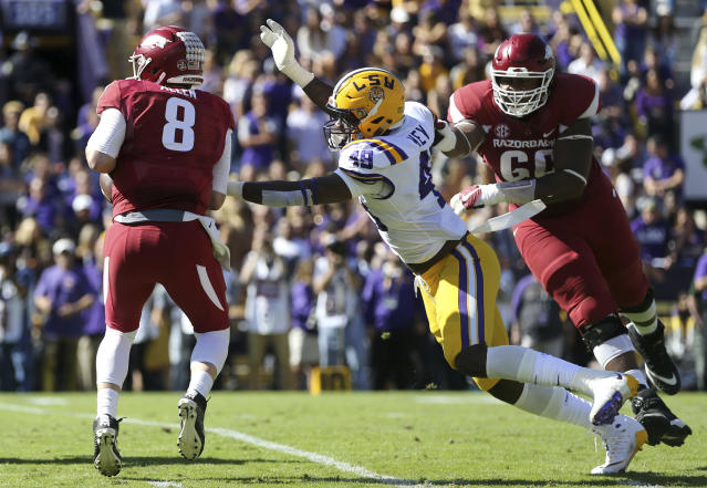 "LSU pass rusher <a class=""link rapid-noclick-resp"" href=""/ncaaf/players/250981/"" data-ylk=""slk:Arden Key"">Arden Key</a> (49) is moving on to the NFL. (AP Photo/Gerald Herbert)"