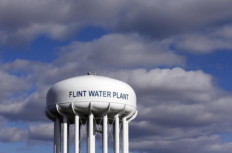 FILE - In this March 21, 2016 file photo, the Flint Water Plant water tower is seen in Flint, Mich. The Trump administration would slash programs aimed at slowing climate change and improving water safety and air quality, while eliminating thousands of jobs, according to a draft of the Environmental Protection Agency budget proposal obtained by the Associated Press.  (AP Photo/Carlos Osorio, File)