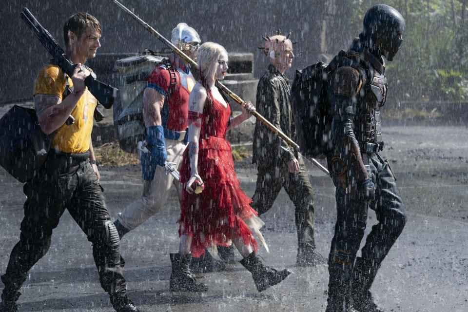 """This image provided by Warner Bros. Pictures shows Joel Kinnaman, from left, John Cena, Margot Robbie, Peter Capaldi and Idris Elba in a scene from """"The Suicide Squad."""" (Jessica Miglio/Warner Bros. Pictures via AP)"""