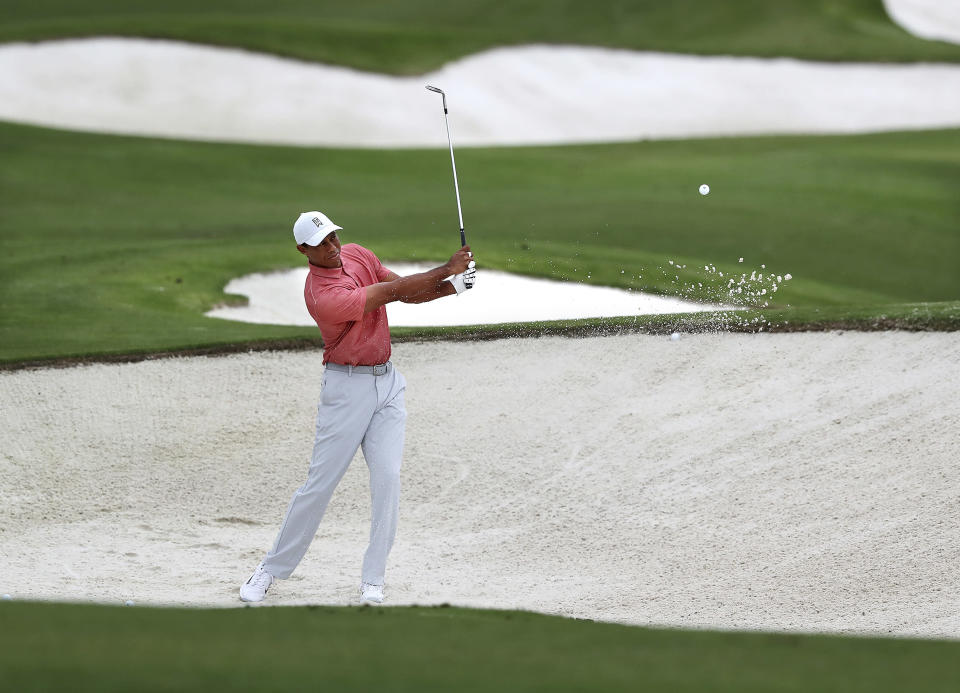 Tiger Woods practices on his sand shots on the practice range at Augusta National Golf Club in Augusta, Ga., Tuesday, Nov 10, 2020. The Masters golf tournament begins Thursday in Augusta. (Curtis ComptonAtlanta Journal-Constitution via AP)