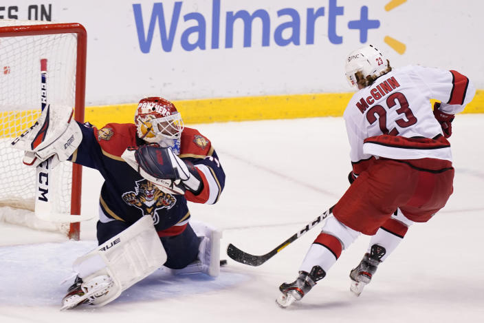 Florida Panthers goaltender Sergei Bobrovsky (72) stops a shot on goal by Carolina Hurricanes left wing Brock McGinn (23) during the second period at an NHL hockey game, Saturday, Feb. 27, 2021, in Sunrise, Fla. (AP Photo/Marta Lavandier)