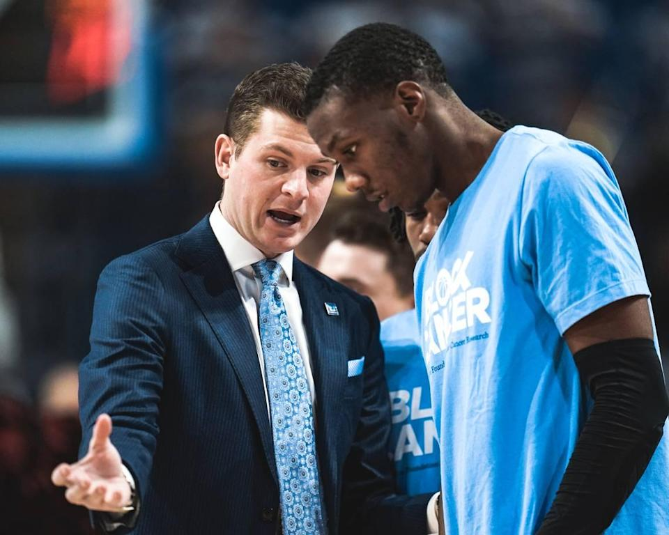 """Saint Louis assistant Ford Stuen, left, instructed a player during a game against VCU. A Henderson County product and the nephew of Billikens head coach Travis Ford, Stuen, 29, died May 11 after contracting a mysterious illness. """"(Stuen) was on the way to being a superstar in this business, a superstar coach,"""" Ford says."""