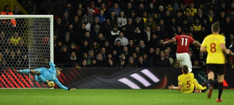 Manchester United's Anthony Martial (R) scores their third goal in a 4-2 win over Watford
