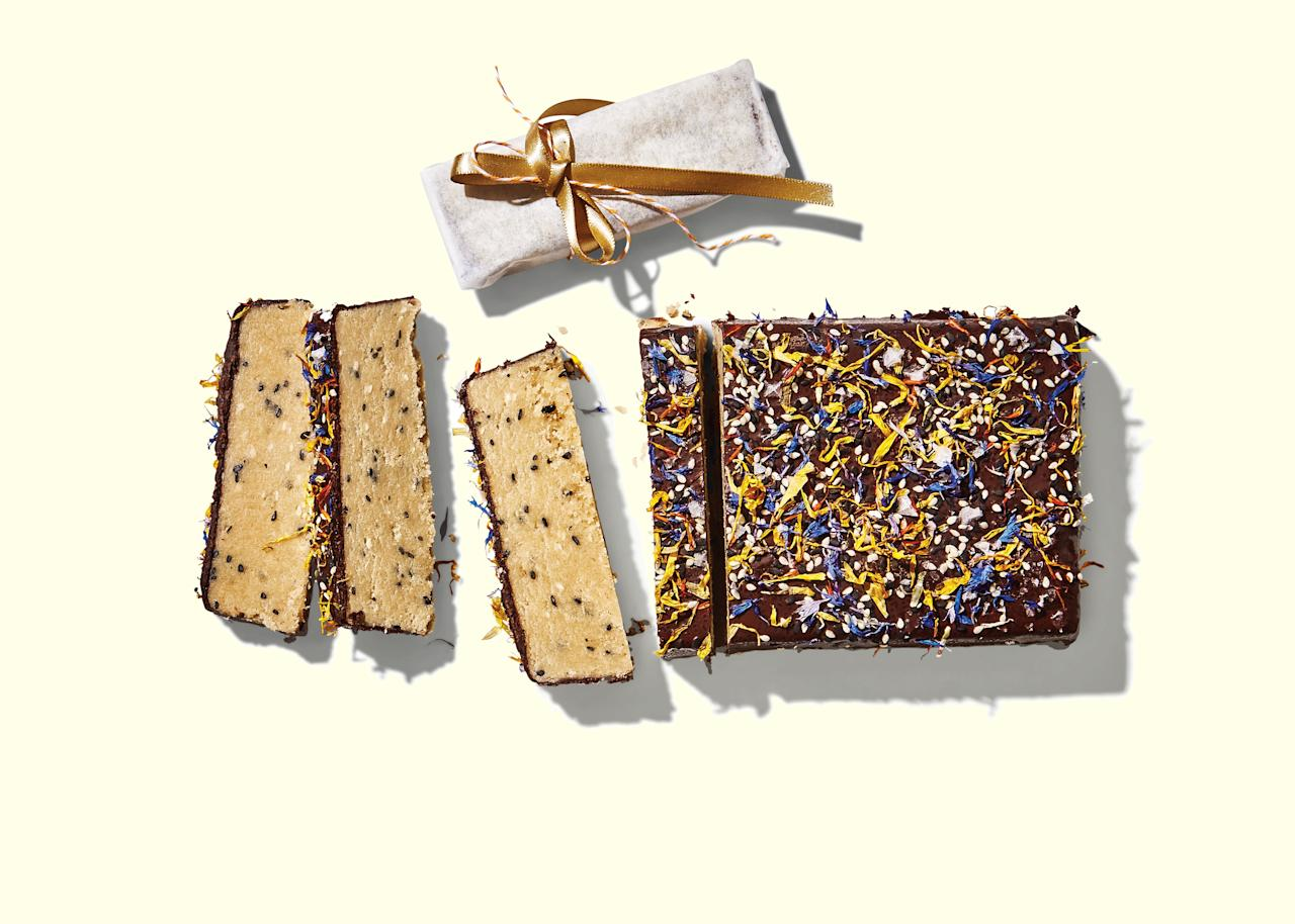 """Salt and bittersweet chocolate lend a savory, sophisticated edge to this typically saccharine-sweet dessert. Halva can be a little tricky to make at first, and a <a href=""""https://www.amazon.com/gp/product/B00004XSC9/ref=s9_acsd_topr_hd_bw_b1DOK_c_x_2_w?pf_rd_m=ATVPDKIKX0DER&pf_rd_s=merchandised-search-6&pf_rd_r=HZVXDNN14Q5S8B66Y6K1&pf_rd_r=HZVXDNN14Q5S8B66Y6K1&pf_rd_t=101&pf_rd_p=da8ebd2e-8d37-4e7a-b962-1f8a727e4a3c&pf_rd_p=da8ebd2e-8d37-4e7a-b962-1f8a727e4a3c&pf_rd_i=289808"""" rel=""""nofollow"""">candy thermometer</a> is key to nailing the right temperature, which creates the desired flaky, crystallized texture. For a holiday party, package each slice up real cute and put it in a basket by the door for guests to take home. <a href=""""https://www.bonappetit.com/recipe/salted-chocolate-halva?mbid=synd_yahoo_rss"""">See recipe.</a>"""