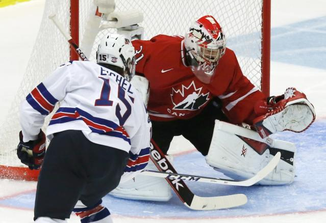 Canada's goalie Zachary Fucale (R) makes a save against United States' Jack Eichel during the first period of their IIHF World Junior Championship ice hockey game in Malmo, Sweden, December 31, 2013. REUTERS/Alexander Demianchuk (SWEDEN - Tags: SPORT ICE HOCKEY)