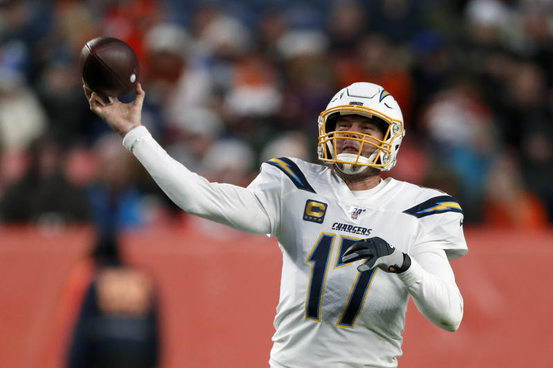 FILE - In this Dec. 1, 2019, file photo, Los Angeles Chargers quarterback Philip Rivers passes against the Denver Broncos during the second half of an NFL football game in Denver. The Indianapolis Colts and longtime Los Angeles Chargers star quarterback Philip Rivers have worked out a one-year contract. That's according to a person who spoke to the Associated Press on condition of anonymity because the deal cannot be officially announced until Wednesday, March 18, 2020. (AP Photo/David Zalubowski, Fle)