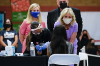 FILE - In this June 30, 2021, file photo first lady Jill Biden speaks to a COVID-19 vaccination recipient during a tour with Doug Emhoff, husband of Vice President Kamala Harris and Phoenix Mayor Kate Gallego at Isaac Middle School in Phoenix. (AP Photo/Carolyn Kaster, Pool, File)