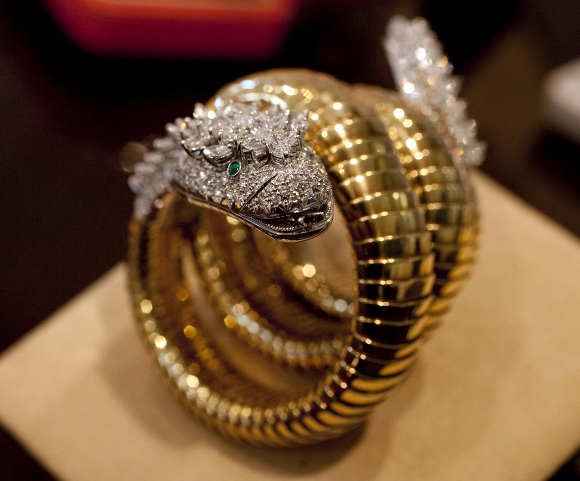 "Elizabeth Taylor's diamond, emerald and gold ""Snake"" bracelet watch, by BVLGARI, circa 1961, estimated at $12,000 - $15,000, is shown in this photograph at Christie's, in New York, Thursday, Sept. 1, 2001. Christie's auction house is selling her complete jewelry collection in New York on Dec. 13-14. (AP Photo/Richard Drew)"