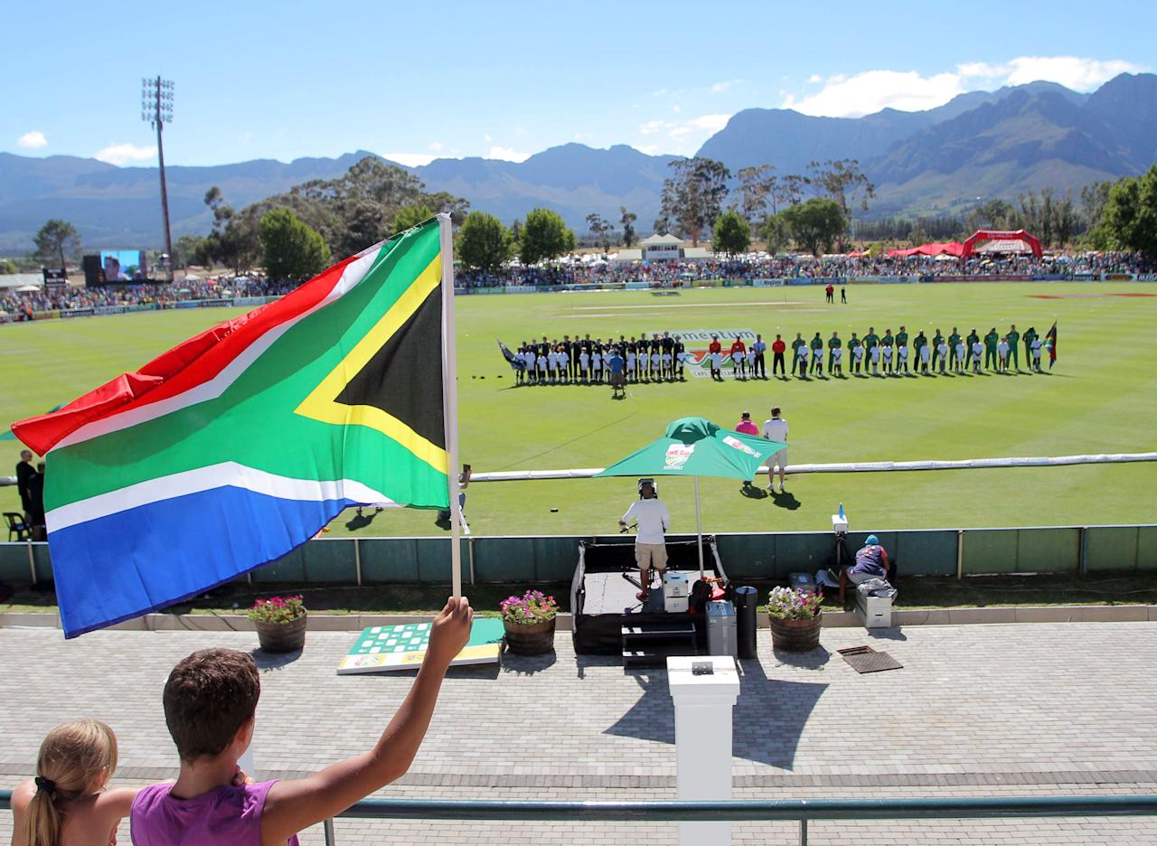 PAARL, SOUTH AFRICA - JANUARY 19:  South Africa fans wave a flag during the 1st One Day International match between South Africa and New Zealand at Boland Park on January 19, 2013 in Paarl, South Africa. (Photo by Carl Fourie/Gallo Images/Getty Images)