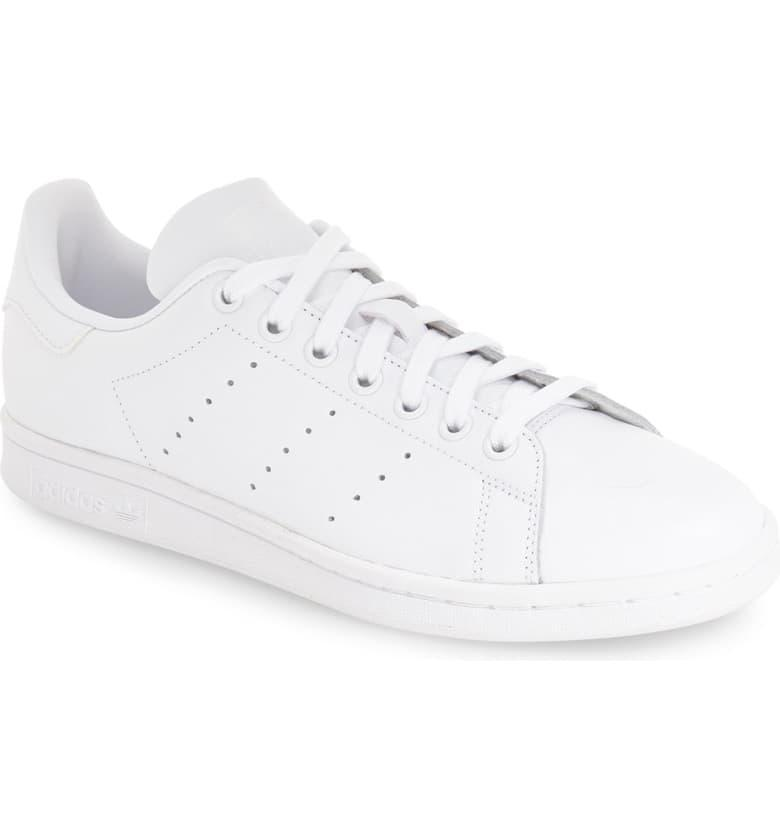 """<h3><strong><h2>Adidas Stan Smith Sneakers</h2></strong></h3><br><strong>Why It's A Best Buy</strong>: The white sneaker is a year-round, effortlessly casual shoe that can worn by stylish humans of any age, identity, and shoe size. Whether you prefer to keep your kicks snowy white or let the wear and tear show, this chameleon-like shoe is truly the blank canvas of footwear. (Pro tip: don't worry about going hunting around for a women's size in this unisex style — <a href=""""https://support.newbalance.com/s/article/NBUS-How-to-Convert-Your-Women-s-Shoe-Size-to-a-Men-s-Shoe-Size"""" rel=""""nofollow noopener"""" target=""""_blank"""" data-ylk=""""slk:just add 1.5 sizes to the men's"""" class=""""link rapid-noclick-resp"""">just add 1.5 sizes to the men's</a>.)<br><br><strong>The Review</strong>: """"I think everyone needs a pair of Stan Smiths. They're comfy, reliable and look great with just about every outfit. [They] are the best day to day sneaker, they're stylish and affordable."""" — Sashafed, Nordstrom.com reviewer<br><br><strong>Adidas</strong> Stan Smith Low Top Sneaker, $, available at <a href=""""https://go.skimresources.com/?id=30283X879131&url=https%3A%2F%2Fwww.nordstrom.com%2Fs%2Fadidas-stan-smith-low-top-sneaker-men%2F4319206"""" rel=""""nofollow noopener"""" target=""""_blank"""" data-ylk=""""slk:Nordstrom"""" class=""""link rapid-noclick-resp"""">Nordstrom</a>"""