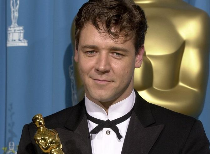 Actor Russell Crowe poses with his Oscar for best actor for his work in