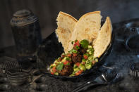 """The Felucian Garden Spread, found at Docking Bay 7 Food and Cargo, is plant-based """"kefta"""" (Morocco's ground-meat kebab) with herb hummus and tomato-cucumber relish, served with pita bread. (Photo: David Roark/Disney Parks)"""