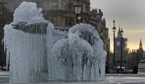 Icicles on the fountain in Trafalgar Square with the background of Big Ben as temperatures dropped below freezing overnight in London, Thursday, Feb. 11, 2021. (AP Photo/Kirsty Wigglesworth)