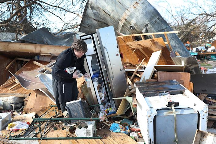 <p>Gavin Conklin, 17, gathers water bottles from a neighbor's refrigerator after Hurricane Michael destroyed the home on Oct. 11, 2018 in Panama City, Fla. (Photo: Joe Raedle/Getty Images) </p>