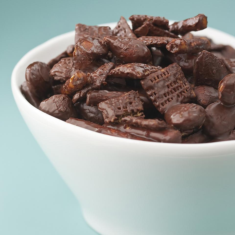 <p>Crunchy wheat cereal, pretzels and almonds coated in bittersweet chocolate makes an addictive sweet-salty snack.</p>