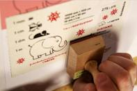 There is no need to moisten the stamps, which come with an adhesive backing already attached