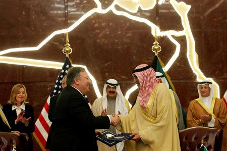 U.S. Secretary of State Mike Pompeo shakes hands with Kuwait's Foreign Minister Sheikh Sabah Al-Khalid Al-Sabah in Kuwait, March 20, 2019.   REUTERS/Jim Young/Pool
