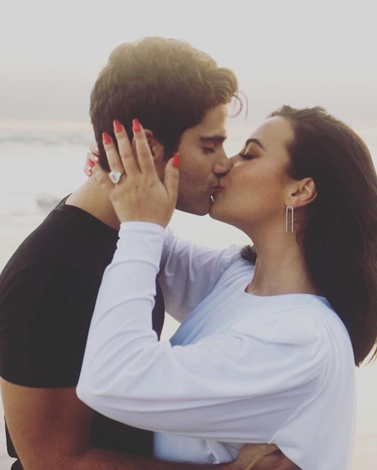 """<p>The superstar singer got a super-sized engagement ring from her fiancé when <a href=""""https://people.com/music/demi-lovato-boyfriend-max-ehrich-are-engaged/"""">he popped the question in July</a>. The jaw-dropping ring was designed by <a href=""""https://people.com/style/demi-lovato-shows-off-huge-engagement-ring-max-ehrich/"""">celebrity jeweler Peter Marco</a> and features a mega-carat emerald-cut diamond stone flanked by two trapezoid diamond side stones.</p> <p>The former <em>Young and the Restless</em> actor asked Lovato to marry him in Malibu and they commemorated the moment with a romantic beachside photo shoot.</p>"""