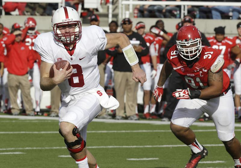 Stanford quarterback Kevin Hogan (8) carries the ball as Utah defensive tackle Tenny Palepoi (91) pursues during the first quarter of an NCAA college football game on Saturday, Oct. 12, 2013, in Salt Lake City. (AP Photo/Rick Bowmer)