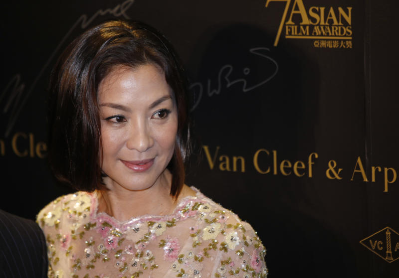 Michelle Yeoh, Hong Kong based Malaysian actress, poses before a cocktail reception to celebrate the recognition of the Excellence in Asian Cinema Award at the 7th Asian Film Awards in Hong Kong Sunday, March 17, 2013. (AP Photo/Vincent Yu)
