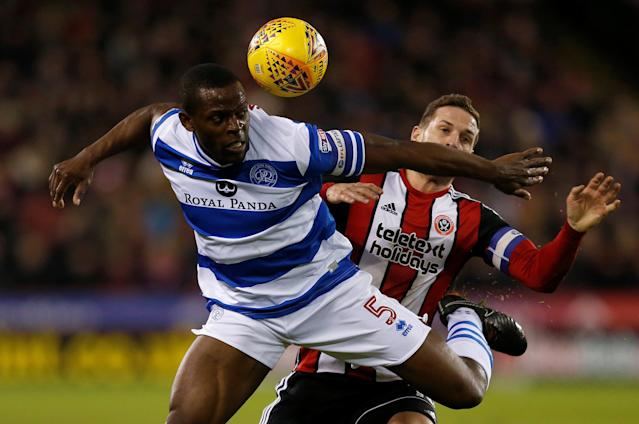 "Soccer Football - Championship - Sheffield United vs Queens Park Rangers - Bramall Lane, Sheffield, Britain - February 20, 2018 Queens Park Rangers' Nedum Onuoha in action with Sheffield United's Billy Sharp Action Images/Ed Sykes EDITORIAL USE ONLY. No use with unauthorized audio, video, data, fixture lists, club/league logos or ""live"" services. Online in-match use limited to 75 images, no video emulation. No use in betting, games or single club/league/player publications. Please contact your account representative for further details."