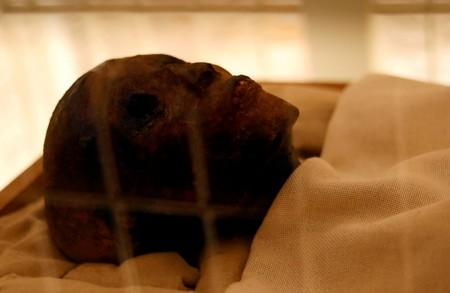 FILE PHOTO: The mummy of boy pharaoh King Tutankhamun is on display in his newly renovated tomb in the Valley of the Kings in Luxor