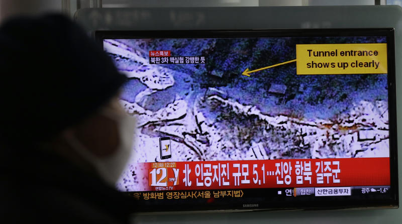 "A South Korean watches news reporting about a possible nuclear test conducted by North Korea on a TV screen at the Seoul train station in Seoul, South Korea, Tuesday, Feb. 12, 2013. The U.S. Geological Survey said Tuesday it had detected a magnitude 4.9 earthquake in North Korea, but neither Pyongyang nor Seoul confirmed whether North Korea had conducted its widely anticipated third nuclear test. The writing reads ""North, Artificial earthquake 5.1."" (AP Photo/Lee Jin-man)"