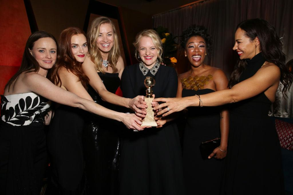 """<p>Last night, the predominantly female cast of <em>The Handmaid's Tale</em> took home the award for Best Drama TV Series and actress Elisabeth Moss dedicated the trophy to author Margaret Atwood.<br /><br />""""Margaret Atwood this is for you, and all of the women who came before you and after you that speak out about injustices,"""" she said. <em>[Photo: Getty]</em> </p>"""