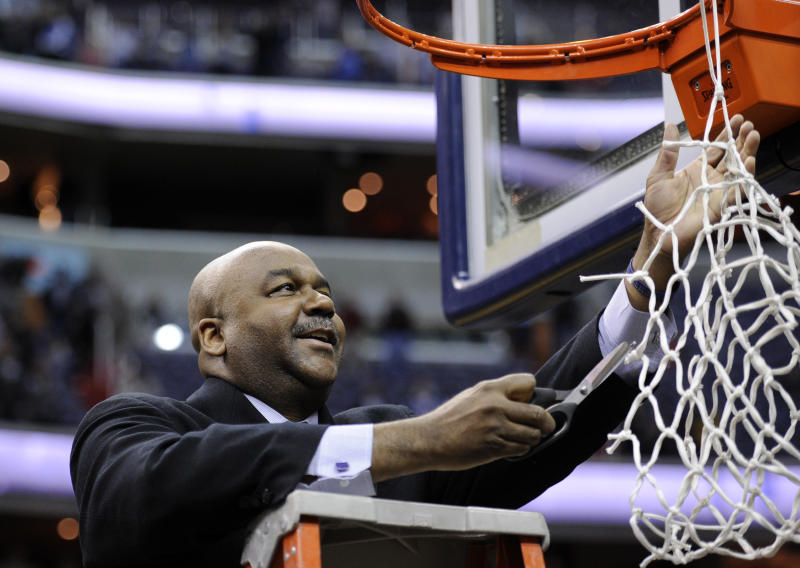 Georgetown head coach John Thompson III goes to cut the net after Georgetown beat Syracuse 61-39 an NCAA college basketball game to win the regular-season Big East Conference title Saturday, March 9, 2013, in Washington. (AP Photo/Nick Wass)