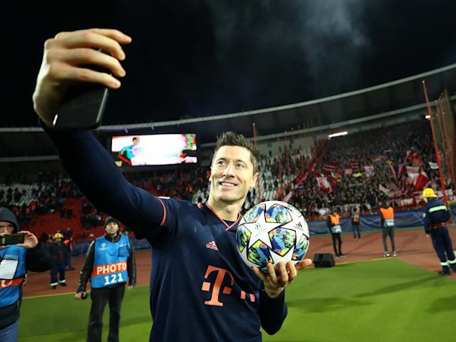 Robert Lewandowski celebrates with the matchball at full-time: Getty