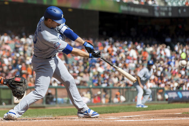 Los Angeles Dodgers David Freese hits an RBI double against the San Francisco Giants in the first inning of a baseball game in San Francisco, Sunday, Sept. 30, 2018. (AP Photo/John Hefti)