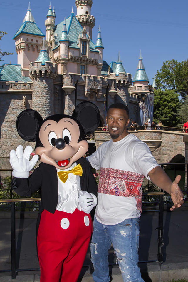 <p>When you're a celeb as big as Foxx, you get perks, such as meeting Mickey Mouse during your visit to the Magic Kingdom. (Photo: Joshua Sudock/Disneyland Resort via Getty Images) </p>