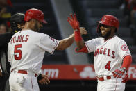 Los Angeles Angels' Luis Rengifo, right, celebrates his three-run home run with Albert Pujols during the second inning of the team's baseball game against the Cincinnati Reds in Anaheim, Calif., Tuesday, June 25, 2019. (AP Photo/Chris Carlson)
