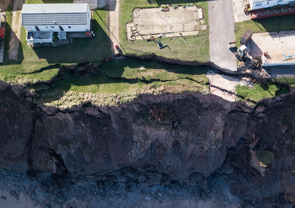 <em>Owners of holiday caravans were shocked to find a 50 metre long crack had opened up along the cliff edge (SWNS)</em>