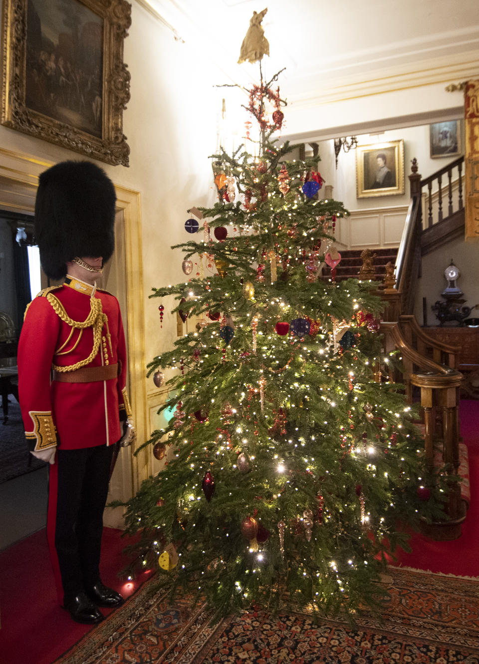 LONDON, ENGLAND - DECEMBER 16: Captain Charles Ross Assistant Equerry with the Clarence House Xmas tree and some of the baubles as the Duchess of Cornwall decorates the Clarence House Christmas Tree virtually with children from Helen & Douglas House Hospice, on December 16, 2020 in London, England. (Photo by Eddie Mulholland - WPA Pool/Getty Images)
