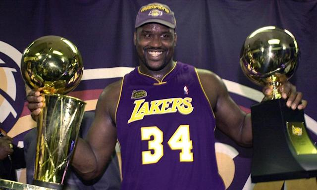"<span class=""element-image__caption"">Shaquille O'Neal holds up the MVP trophy and the championship trophy after the Lakers won their second straight NBA championship in 2001.</span> <span class=""element-image__credit"">Photograph: Mark J Terrill/AP</span>"