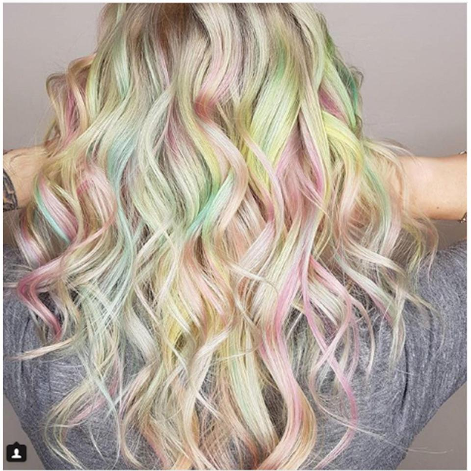 Pulp Riot colorist Kelly O'Leary-Woodford used a blonde base and a mixture of pastel yellows, pinks, and greens to create her version of opalescent hair.