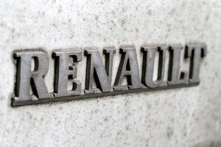 A Renault logo covered with mud and dust is seen on a car in Paris