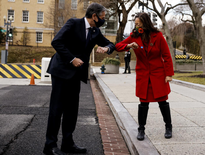 Newly confirmed U.S. Secretary of State Antony Blinken is greeted with an elbow bump as he arrives for a welcome ceremony at the State Department, Wednesday, Jan. 27, 2021 in Washington. (Carlos Barria/Pool via AP)