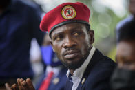 Opposition presidential challenger Bobi Wine, speaks to the media outside his home, in Magere, near Kampala, in Uganda Tuesday, Jan. 26, 2021. An attorney for Bobi Wine says Ugandan soldiers have withdrawn from the opposition presidential challenger's home the day after a judge ruled that his house arrest was unlawful. But the attorney tells The Associated Press that security forces can still be seen in the village near the candidate's property outside the capital, Kampala. (AP Photo/Nicholas Bamulanzeki)