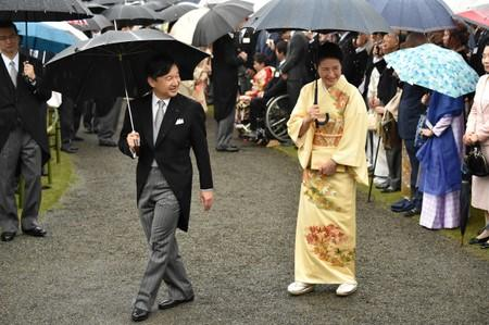 FILE PHOTO: Japan's Crown Prince Naruhito and Crown Princess Masako greet guests during an autumn garden party at Akasaka Palace Imperial garden in Tokyo