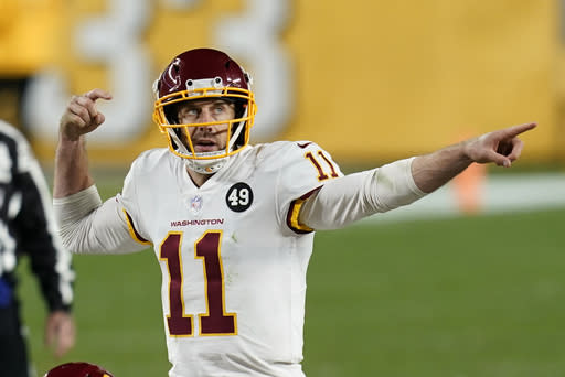 Washington Football Team quarterback Alex Smith (11) calls a play during the second half of an NFL football game against the Pittsburgh Steelers, Monday, Dec. 7, 2020, in Pittsburgh. (AP Photo/Keith Srakocic)