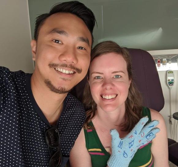 Justin Tham and Sarah Foster pose for a picture in hospital.