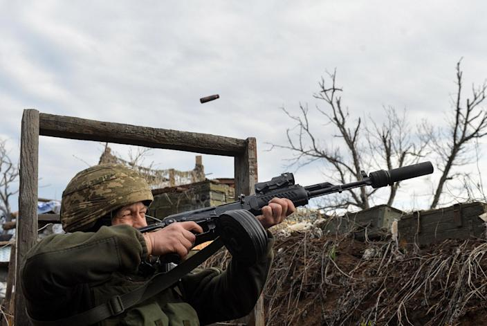 Image: A Ukrainian soldier attempts to shoot down a suspected drone near Donetsk. (Oleksandr Klymenko / Reuters)